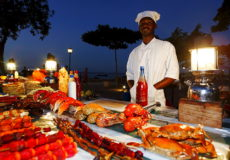 Monger at a stand, night market at Forodhani Gardens, Stonetown, Zanzibar City, Zanzibar, Tanzania, Africa